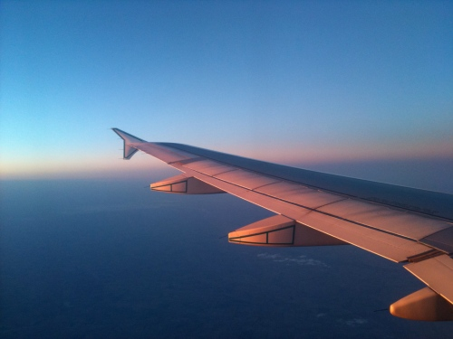 Sun setting over the wing